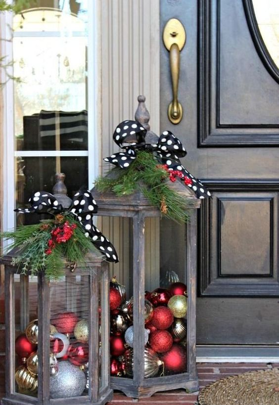 Christmas Decoration Inspiration - lanterns filled with holiday ornaments on the front porch. So cute!