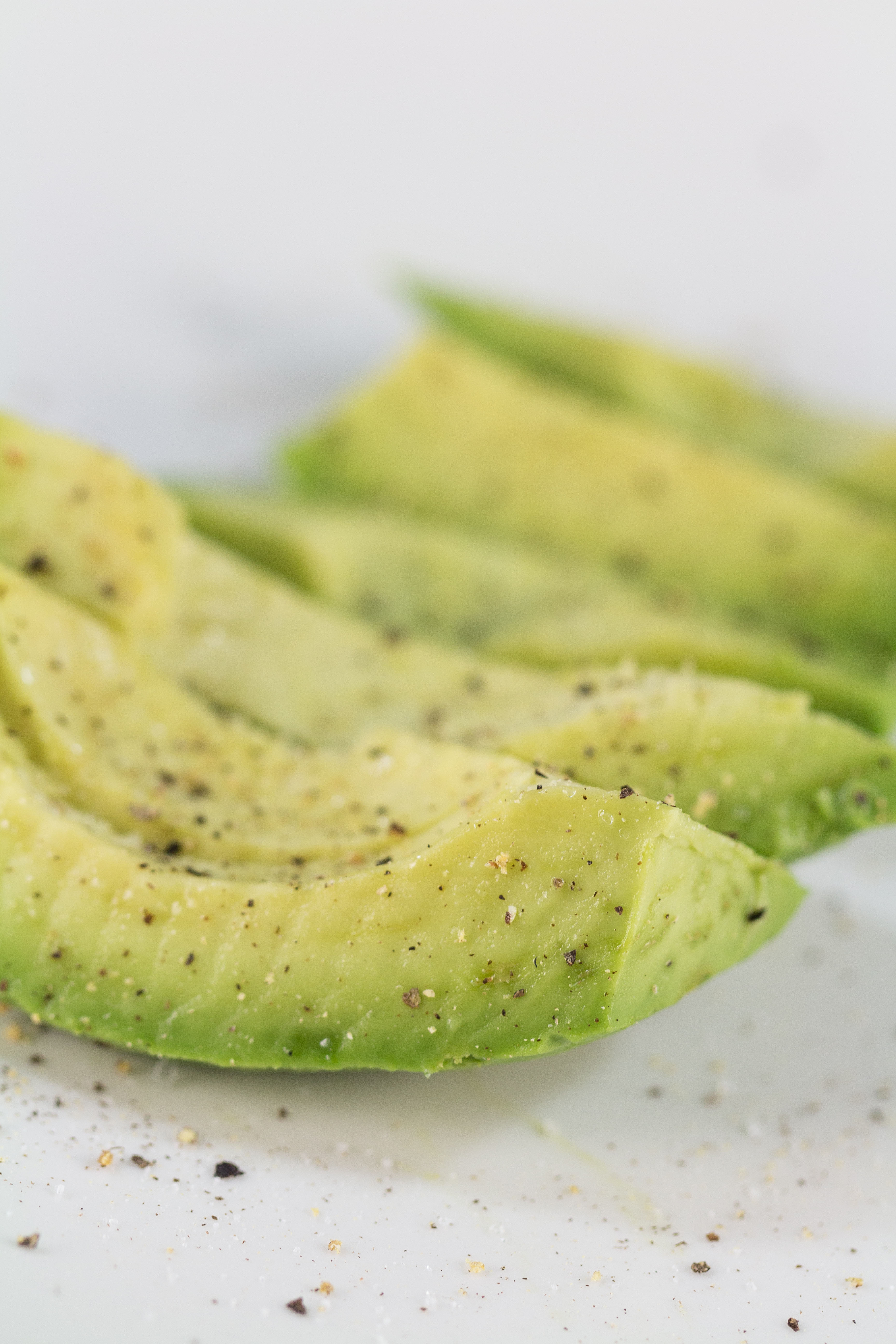 Sliced Avocado With Salt and Pepper | https://www.roseclearfield.com