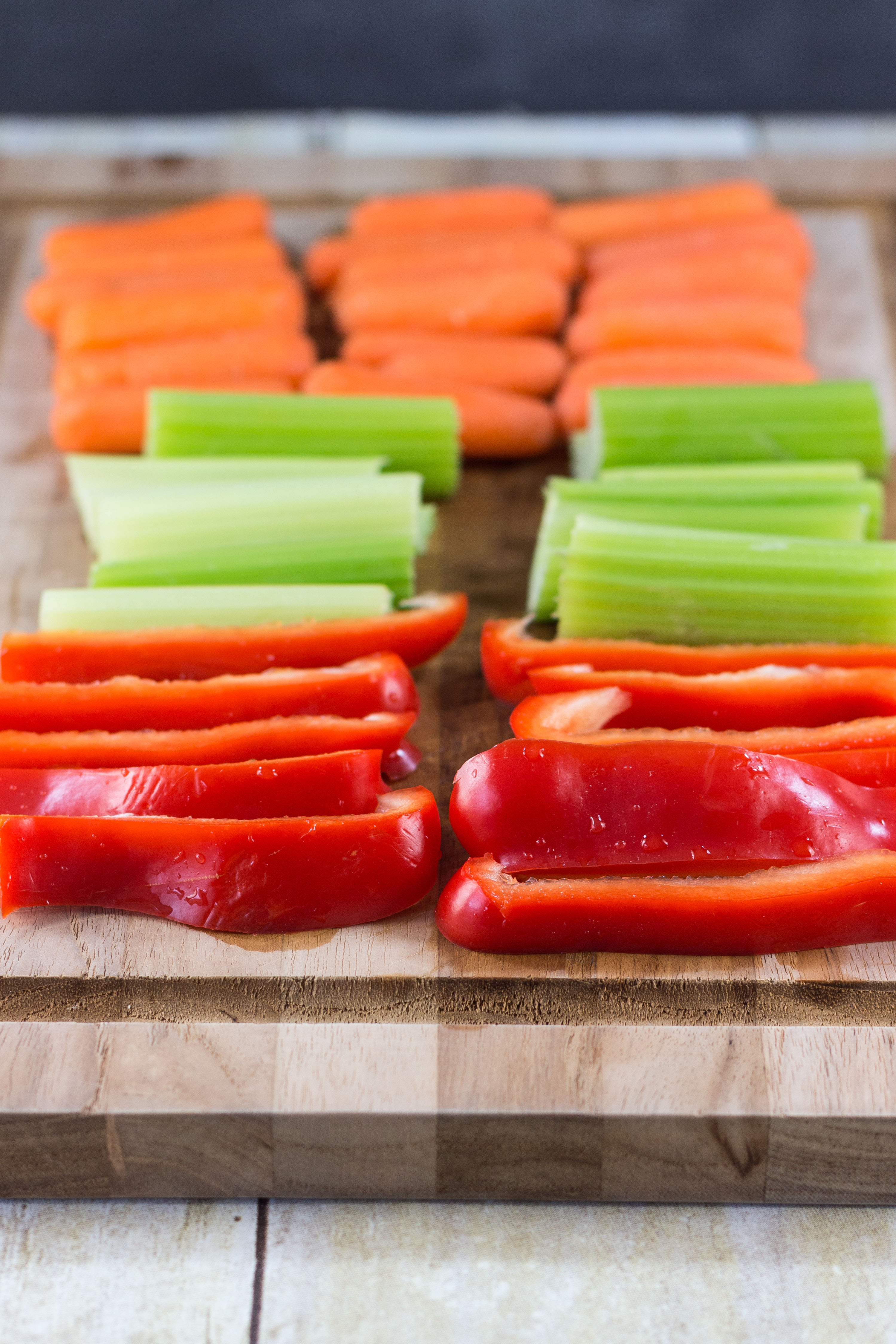 Chopped veggies ready to pair with homemade hummus. Click through for a fabulous white bean hummus recipe! | https://www.roseclearfield.com