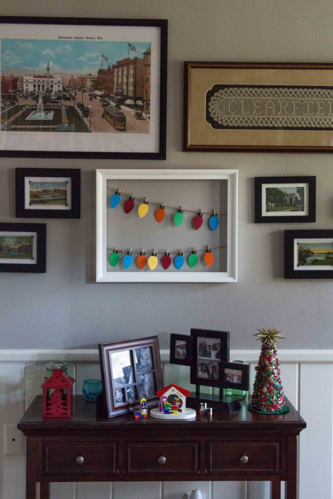 A handmade paper Christmas lights display is perfect for an entryway or living room. | https://www.roseclearfield.com