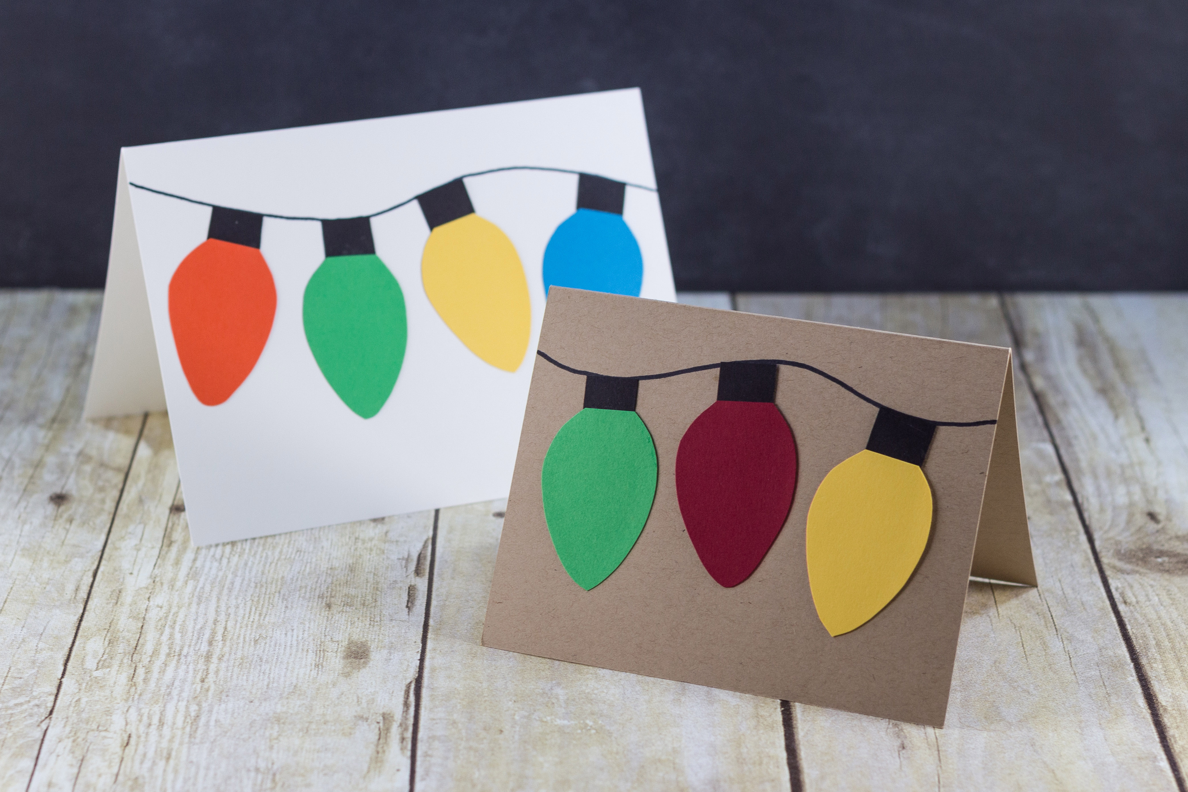Handmade holiday cards with DIY paper Christmas lights. | https://www.roseclearfield.com