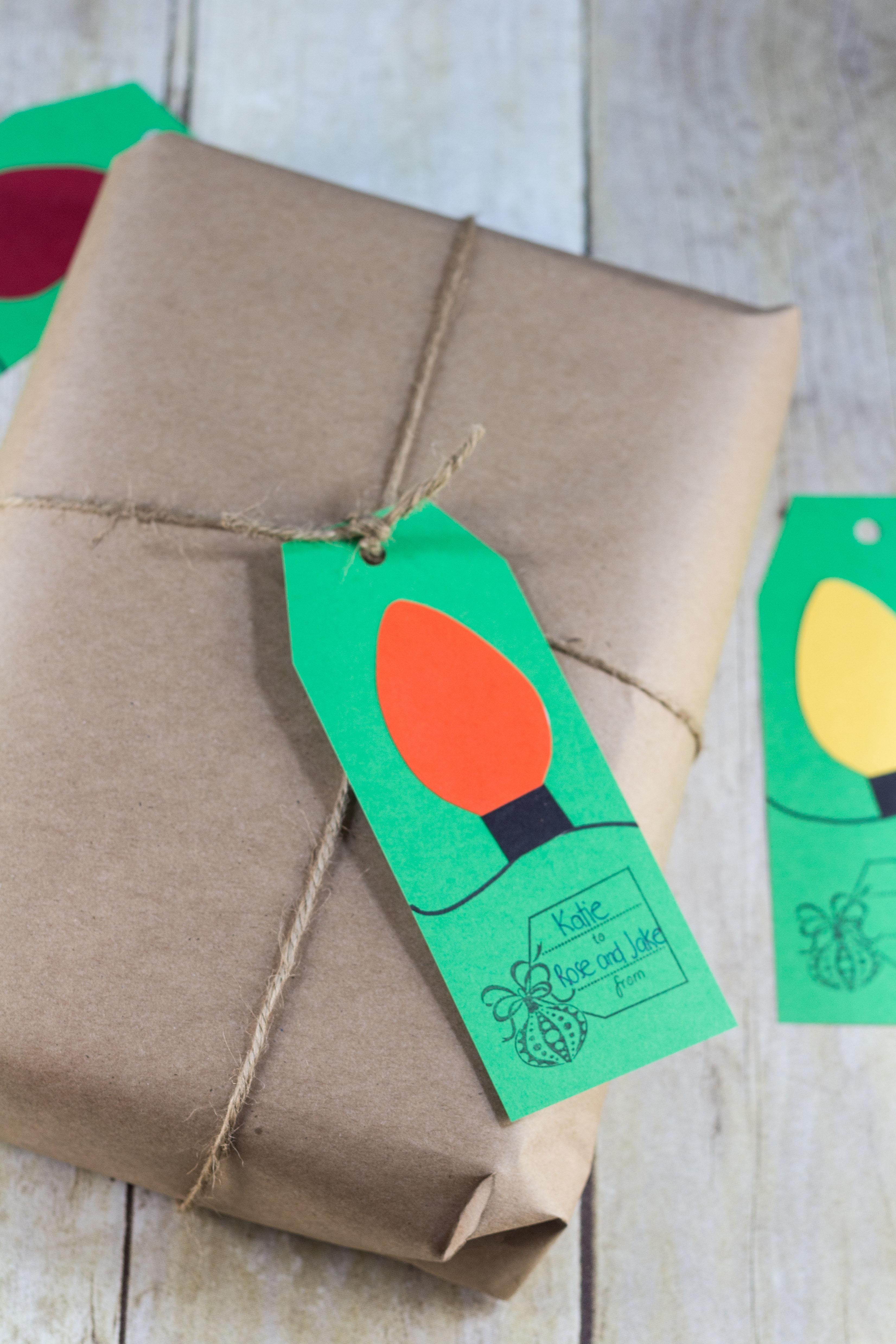 Paper Christmas light gift tags. I used green to pair with kraft wrapping, but I love kraft gift tags, too. | https://www.roseclearfield.com