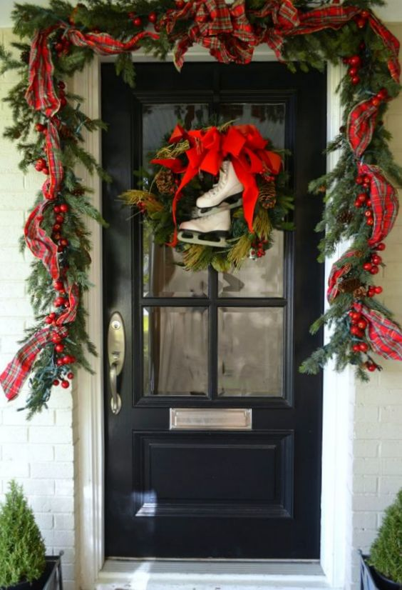 Christmas Decoration Inspiration - garland and ice skates for the front door.