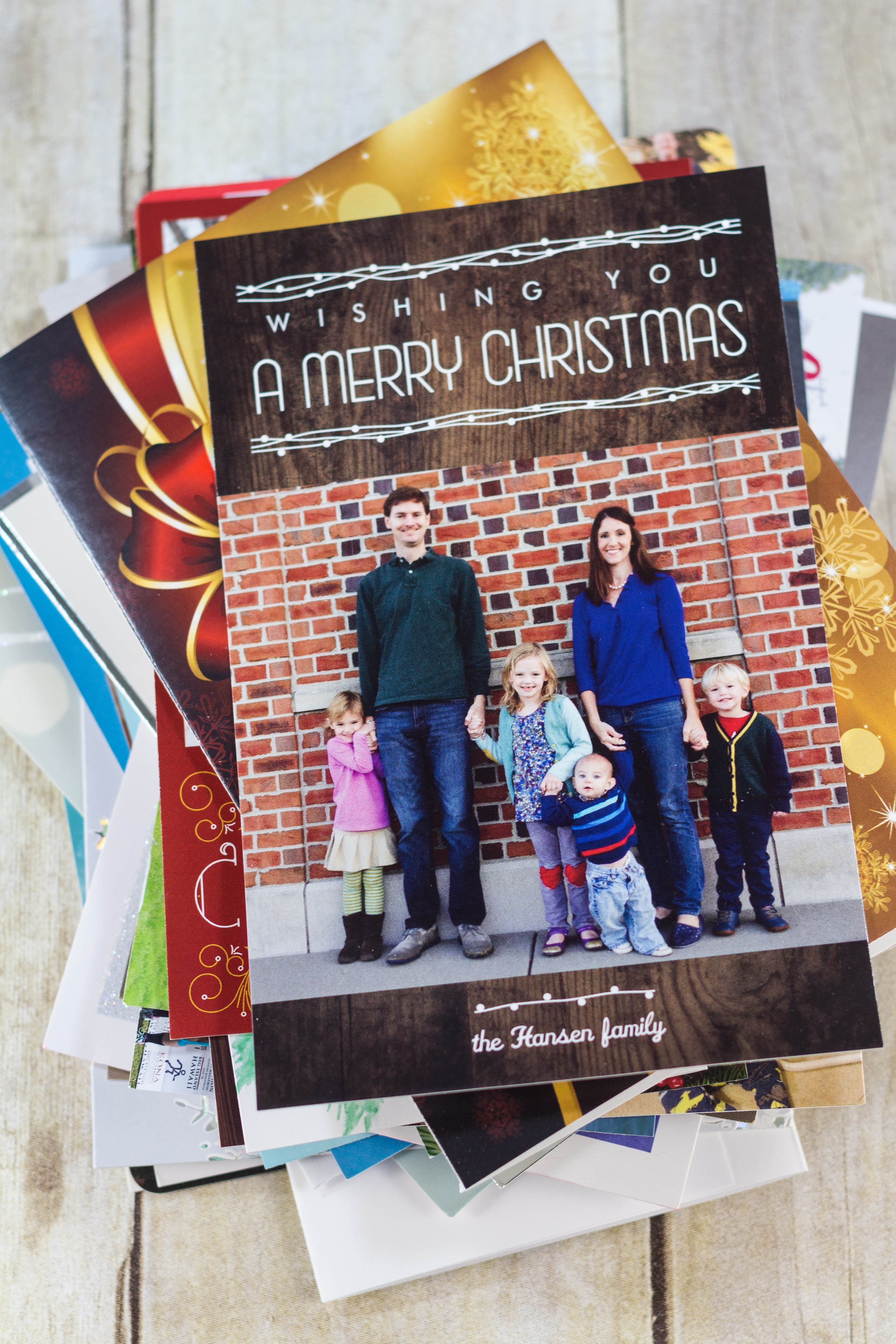 DIY Upcycled Christmas Card Books - Christmas cards, letters, and photos ready for the book. | https://www.roseclearfield.com