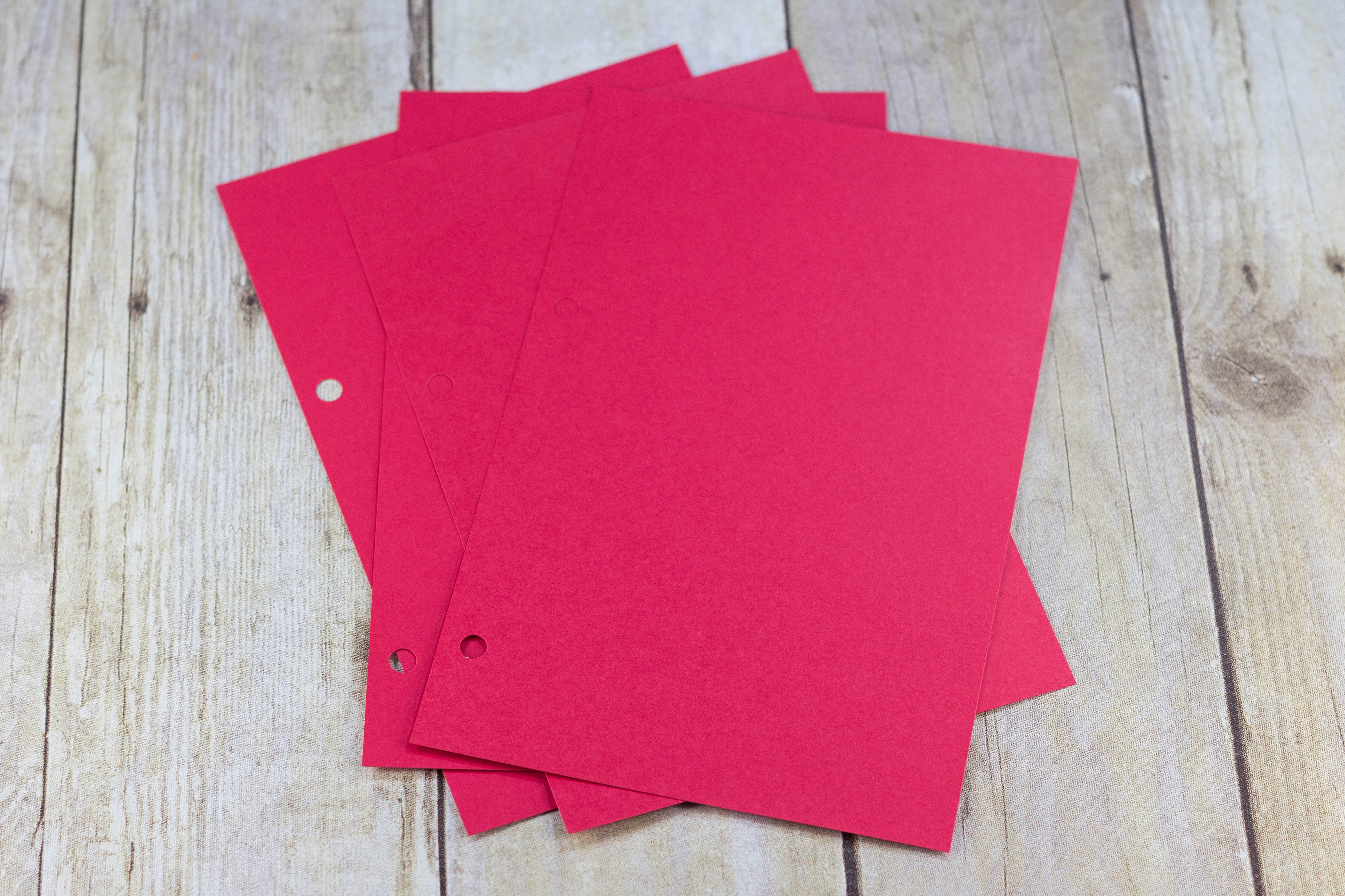 DIY Upcycled Christmas Card Books - Red cardstock cut in halves for gluing Christmas photos and letters. | https://www.roseclearfield.com