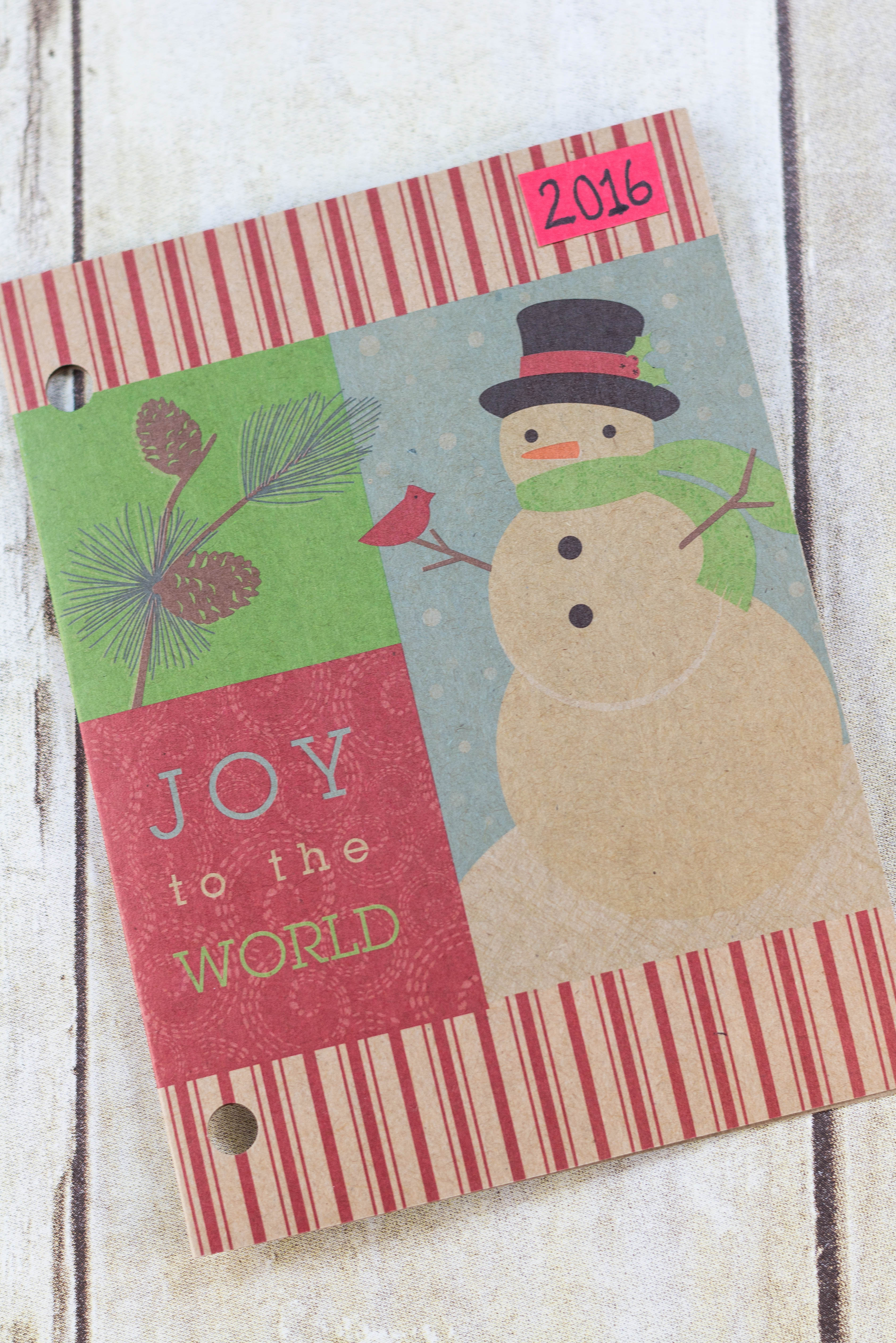 DIY Upcycled Christmas Card Books - I like to use a portrait oriented Christmas card with no photo for the cover. | https://www.roseclearfield.com