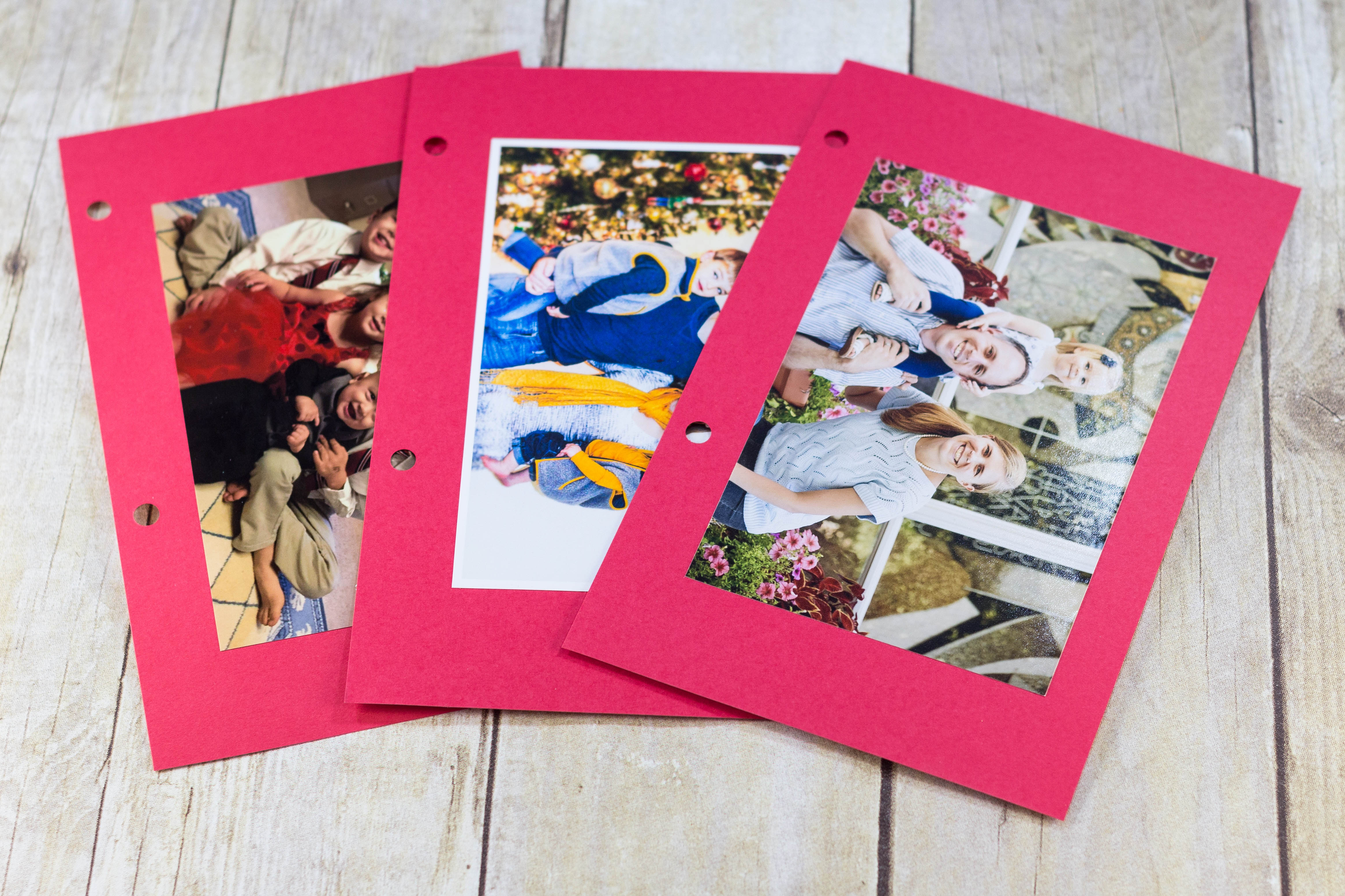 DIY Upcycled Christmas Card Books - I glue the photos to red cardstock. If there's a message or info on the back of the photos (i.e. kids' ages), you may want to write it on the cardstock. | https://www.roseclearfield.com
