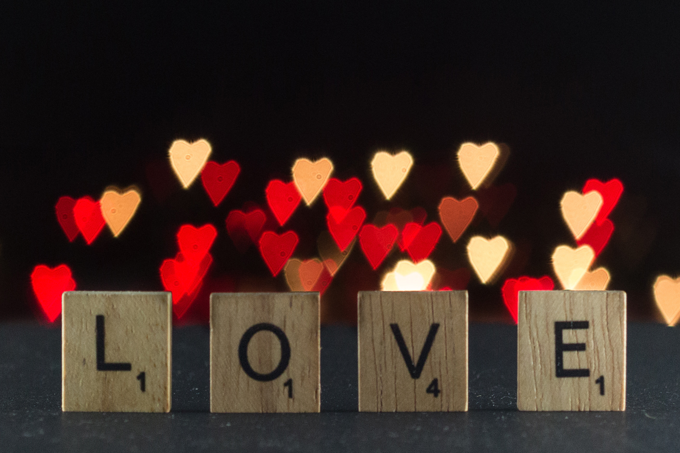 Scrabble tiles LOVE letters with DIY heart bokeh background for Valentine's Day. | https://www.roseclearfield.com