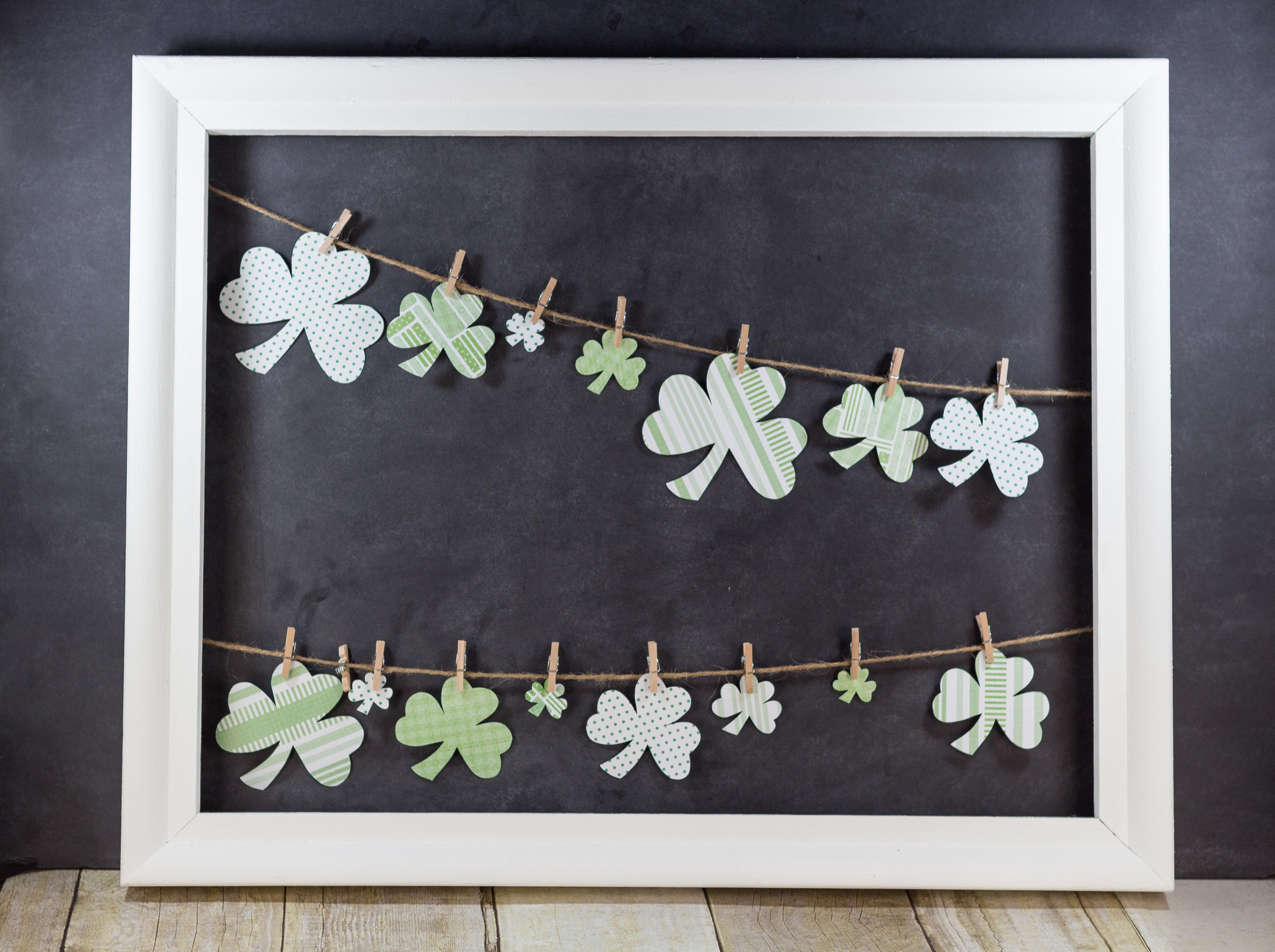 DIY St. Patrick's Day Shamrocks Hanging in Open White Frame | https://www.roseclearfield.com