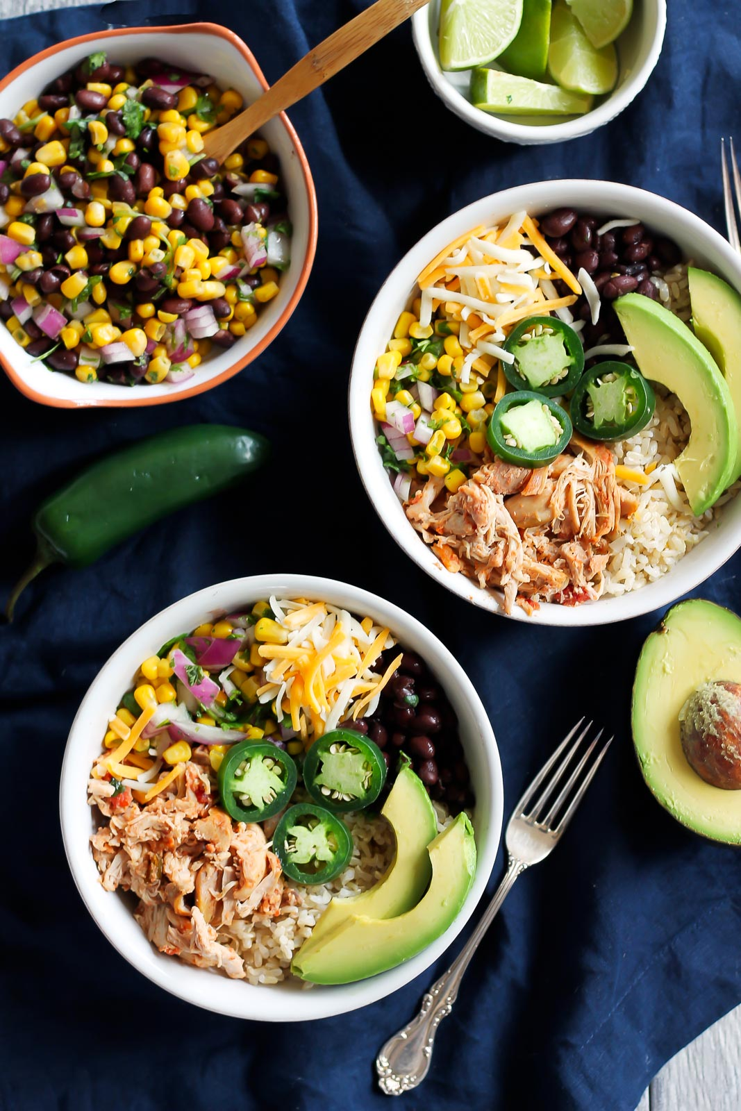 30 Days of Healthy Chicken Dinner Recipes - Chicken Burrito Bowls via Ambitious Kitchen   https://www.roseclearfield.com