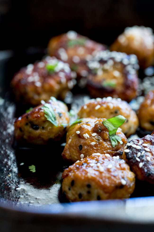 30 Days of Healthy Chicken Dinner Recipes - Tray Baked Sticky Sesame Chicken Meatballs via Sprinkles and Sprouts | https://www.roseclearfield.com