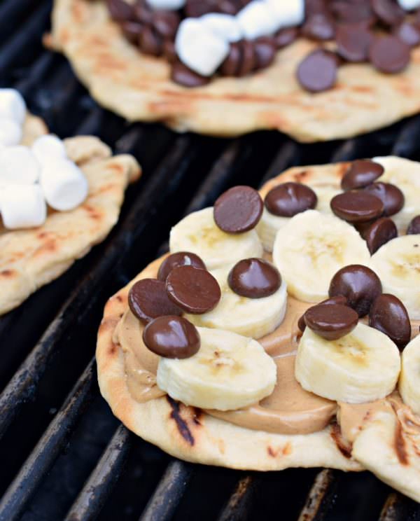 30 Days of Grilled Desserts - Grilled Dessert Pizza with Peanut Butter, Bananas, and Chocolate Chips via Shugary Sweets | https://www.roseclearfield.com
