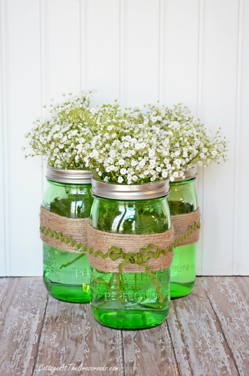 Green Mason Jars Baby's Breath Centerpiece via Cottage at the Crossroads | https://www.roseclearfield.com
