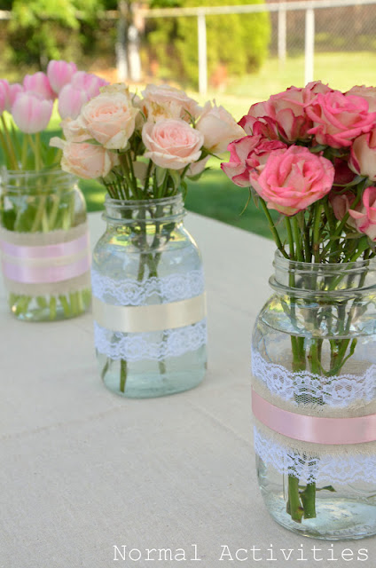 Spring Mason Jar Decor - Lace and Ribbon Wrapped Mason Jar Vases via Normal Activities | https://www.roseclearfield.com