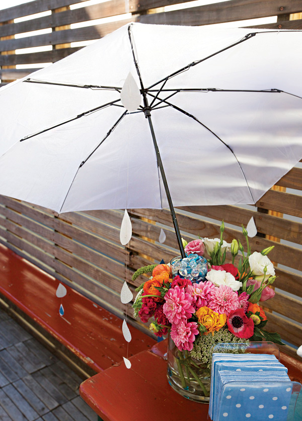 April Showers Bring May Flowers Baby Shower - Umbrella Floral Centerpiece via Hostess with the Mostess | https://www.roseclearfield.com