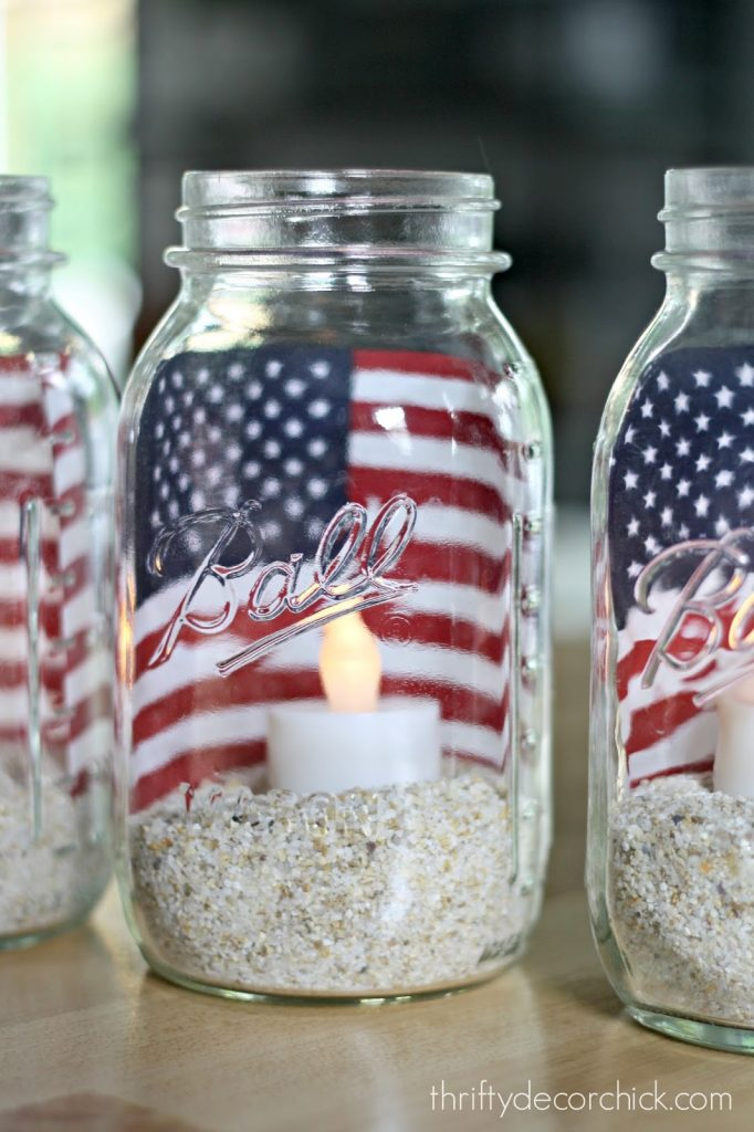 4th of July Mason Jar Decor - American Flag LED Candle Mason Jars via Thrifty Decor Chick | https://www.roseclearfield.com