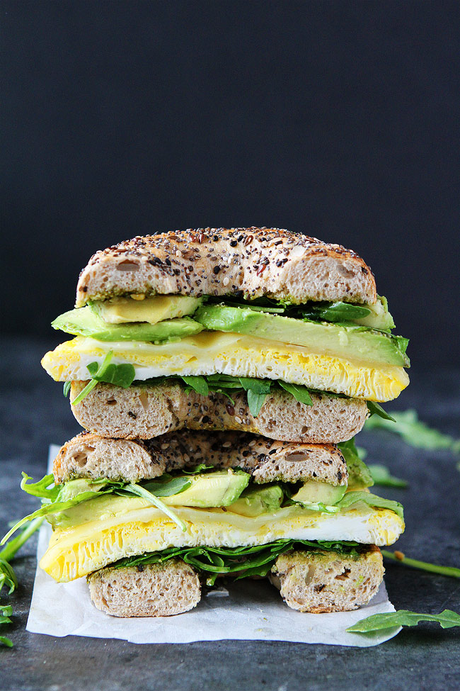 Breakfast for Dinner Ideas - Egg Avocado and Pesto Bagel Sandwich via Two Peas and Their Pod | https://www.roseclearfield.com