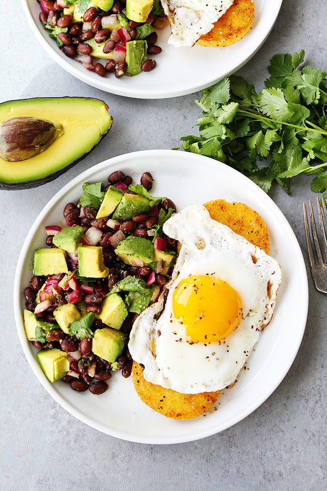 Breakfast for Dinner Ideas - Polenta Rounds with Fried Eggs and Avocado Bean Salsa via Two Peas and Their Pod | https://www.roseclearfield.com