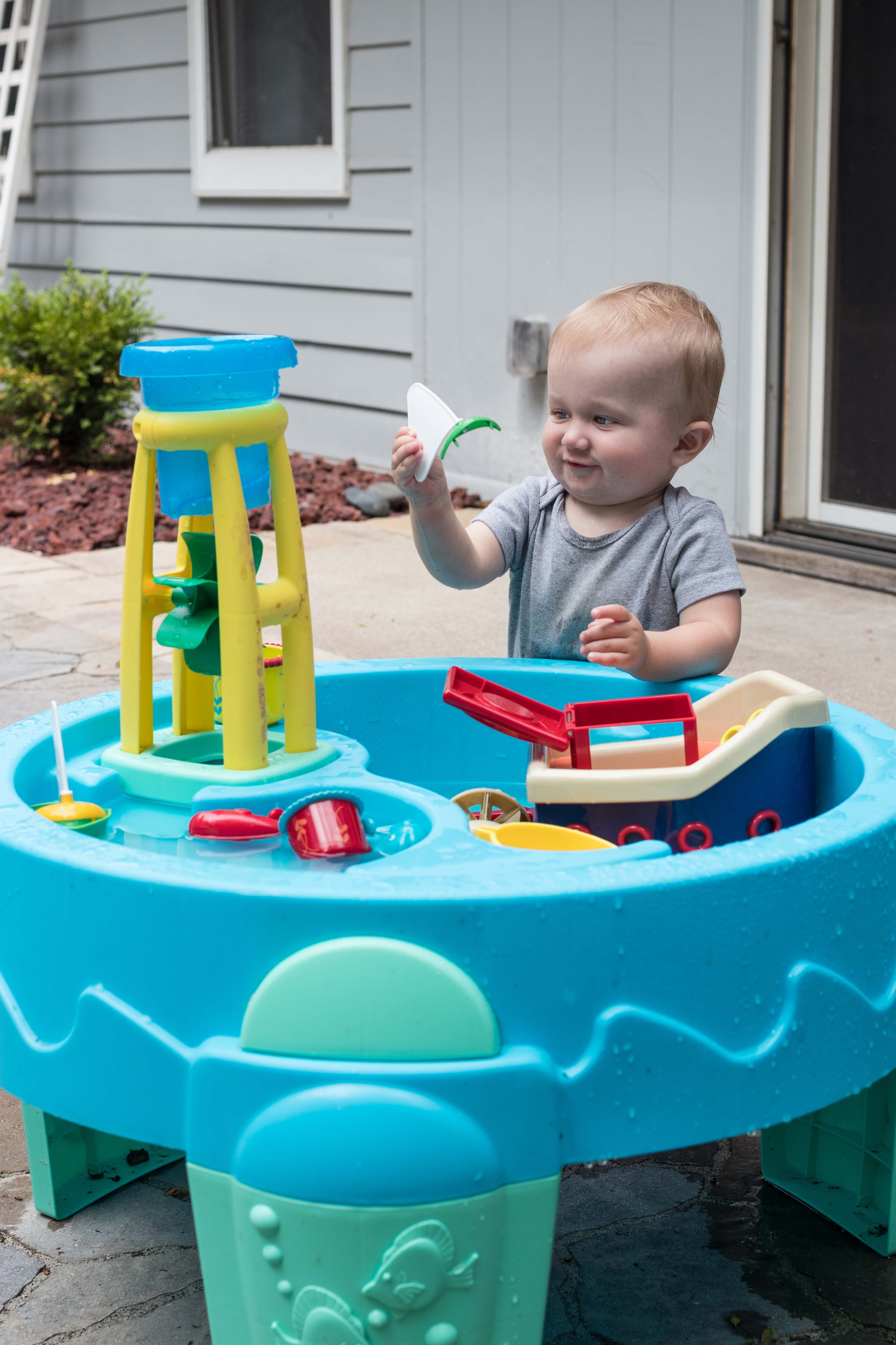 Tommy at the Water Table July 2018   https://www.roseclearfield.com