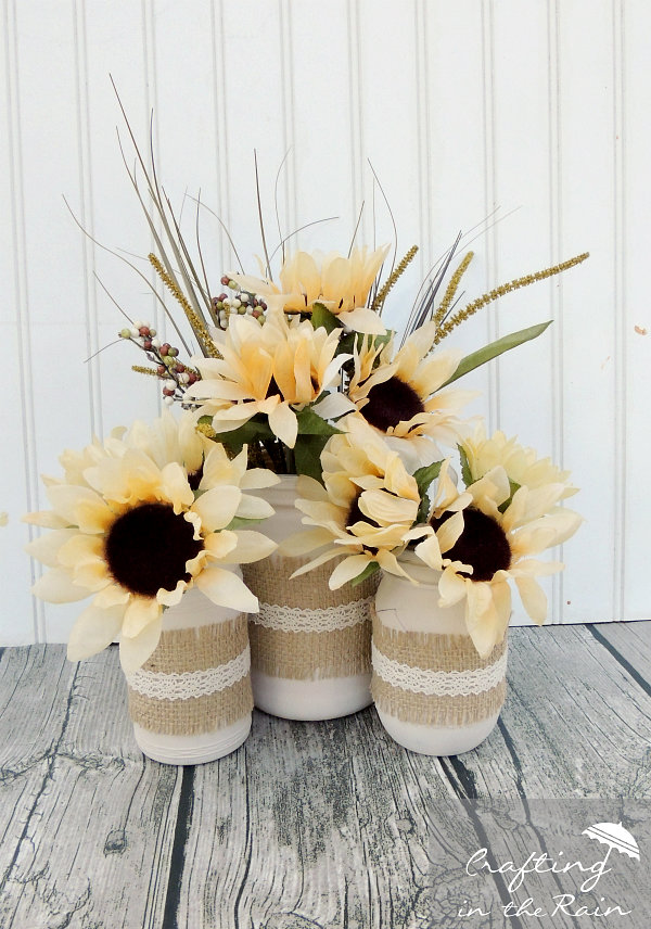 DIY Fall Mason Jar Decor - Fall Mason Jars with Burlap and Flowers via Crafting in the Rain | https://www.roseclearfield.com