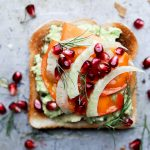 Fall and Winter Avocado Toast Recipes - Avocado Toast with Persimmon Pomegranate and Fennel via Floating Kitchen | https://www.roseclearfield.com