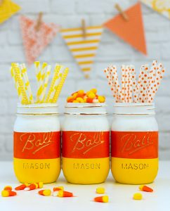 DIY Halloween Mason Jar Decor - Candy Corn Mason Jars for Halloween via Mason Jar Crafts Love | https://www.roseclearfield.com