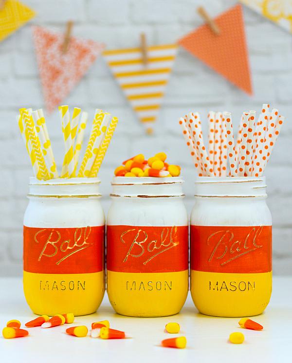 DIY Halloween Mason Jar Decor - Candy Corn Mason Jars for Halloween via Mason Jar Crafts Love | https://www.roseclearfield.com