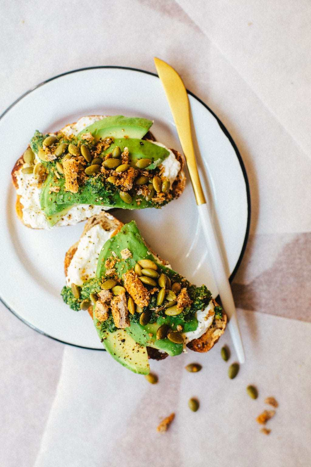 Fall and Winter Avocado Toast Recipes - Fall Avocado Toast with Kale Pesto and Ricotta via Brewing Happiness   https://www.roseclearfield.com