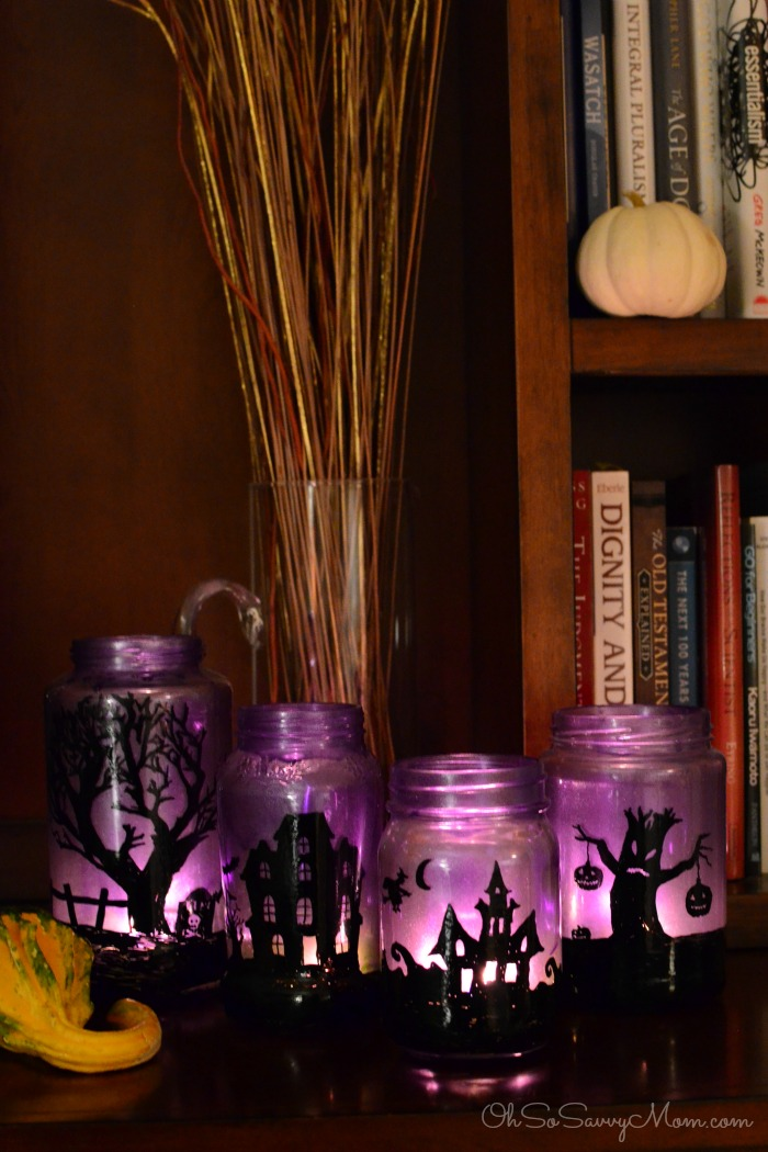 DIY Halloween Mason Jar Decor - Halloween Village Mason Jar Luminaries via Oh So Savvy Mom | https://www.roseclearfield.com