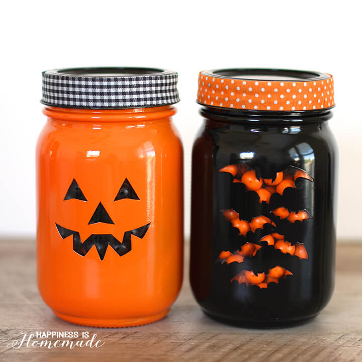 DIY Halloween Mason Jar Decor - Stenciled Halloween Mason Jars via Happiness is Homemade | https://www.roseclearfield.com