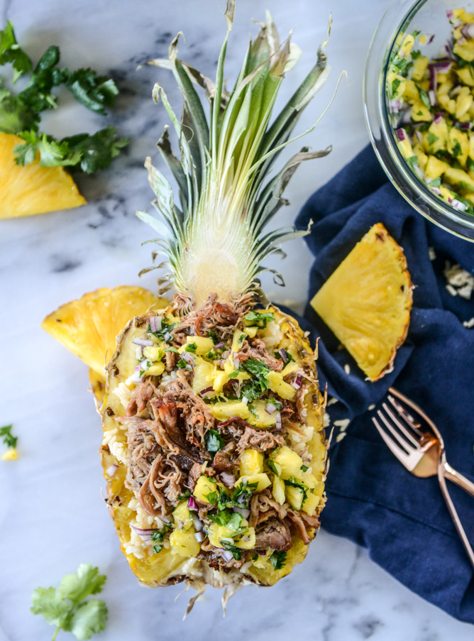 30 Days of Healthy Slow Cooker Dinner Recipes - Slow Cooker Jerk Pork in Pineapple Rice Bowls via How Sweet Eats | https://www.roseclearfield.com