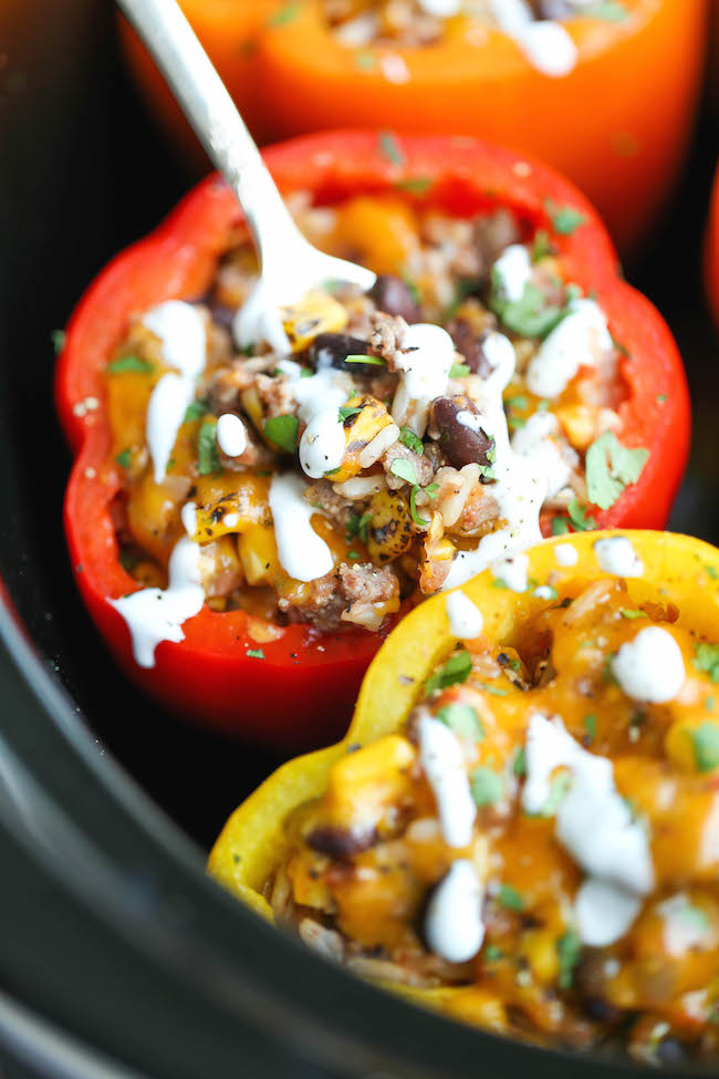 30 Days of Healthy Slow Cooker Dinner Recipes - Slow Cooker Stuffed Peppers via Damn Delicious | https://www.roseclearfield.com