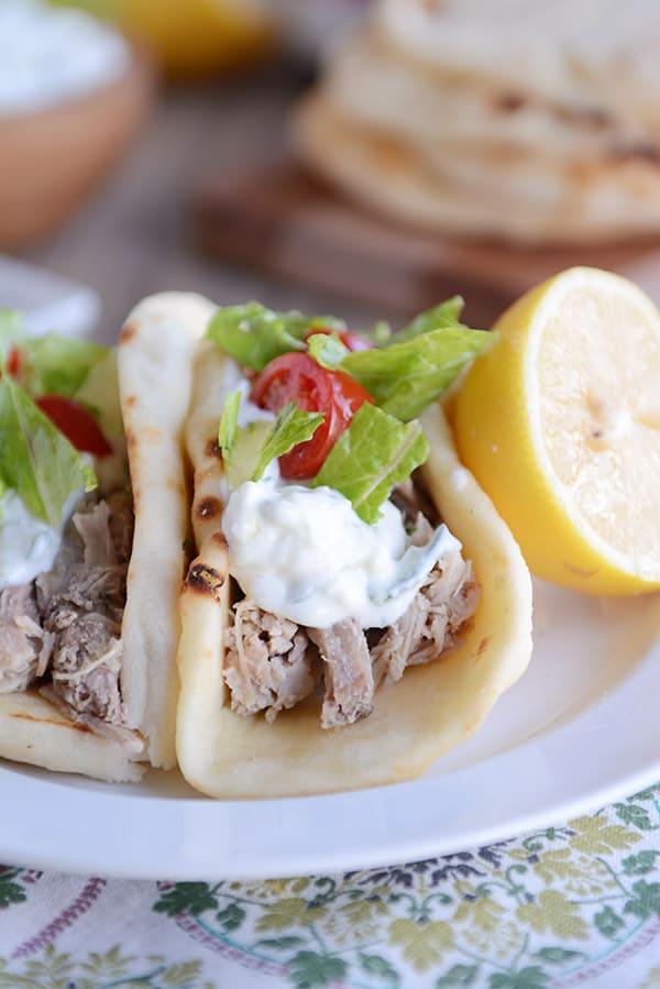 30 Days of Healthy Slow Cooker Dinner Recipes - Tender Greek Pork via Mel's Kitchen Cafe | https://www.roseclearfield.com