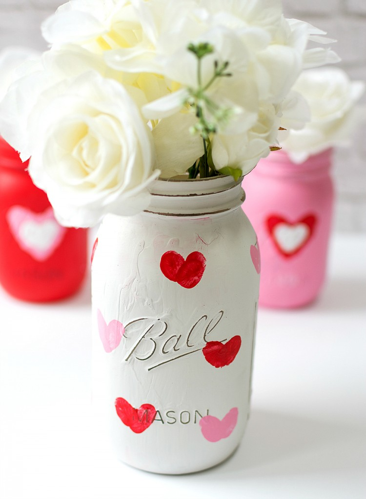 DIY Valentine's Day Mason Jar Decor - Valentine Kid Craft Thumbprint Heart Mason Jars via It All Started With Paint | https://www.roseclearfield.com