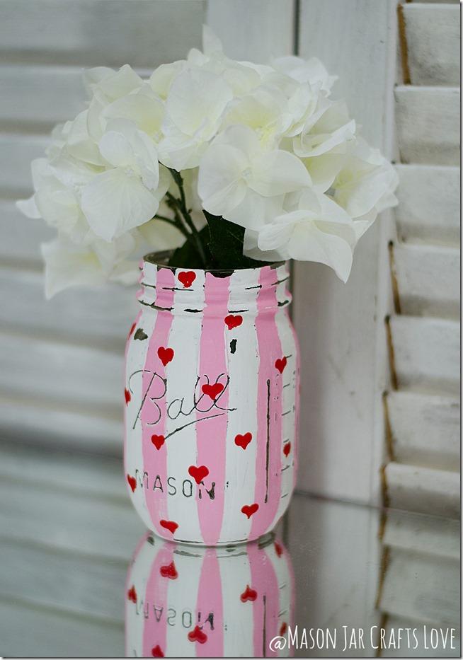 DIY Valentine's Day Mason Jar Decor - Valentine's Day Striped Heart Distressed Mason Jars via Mason Jar Crafts Love | https://www.roseclearfield.com
