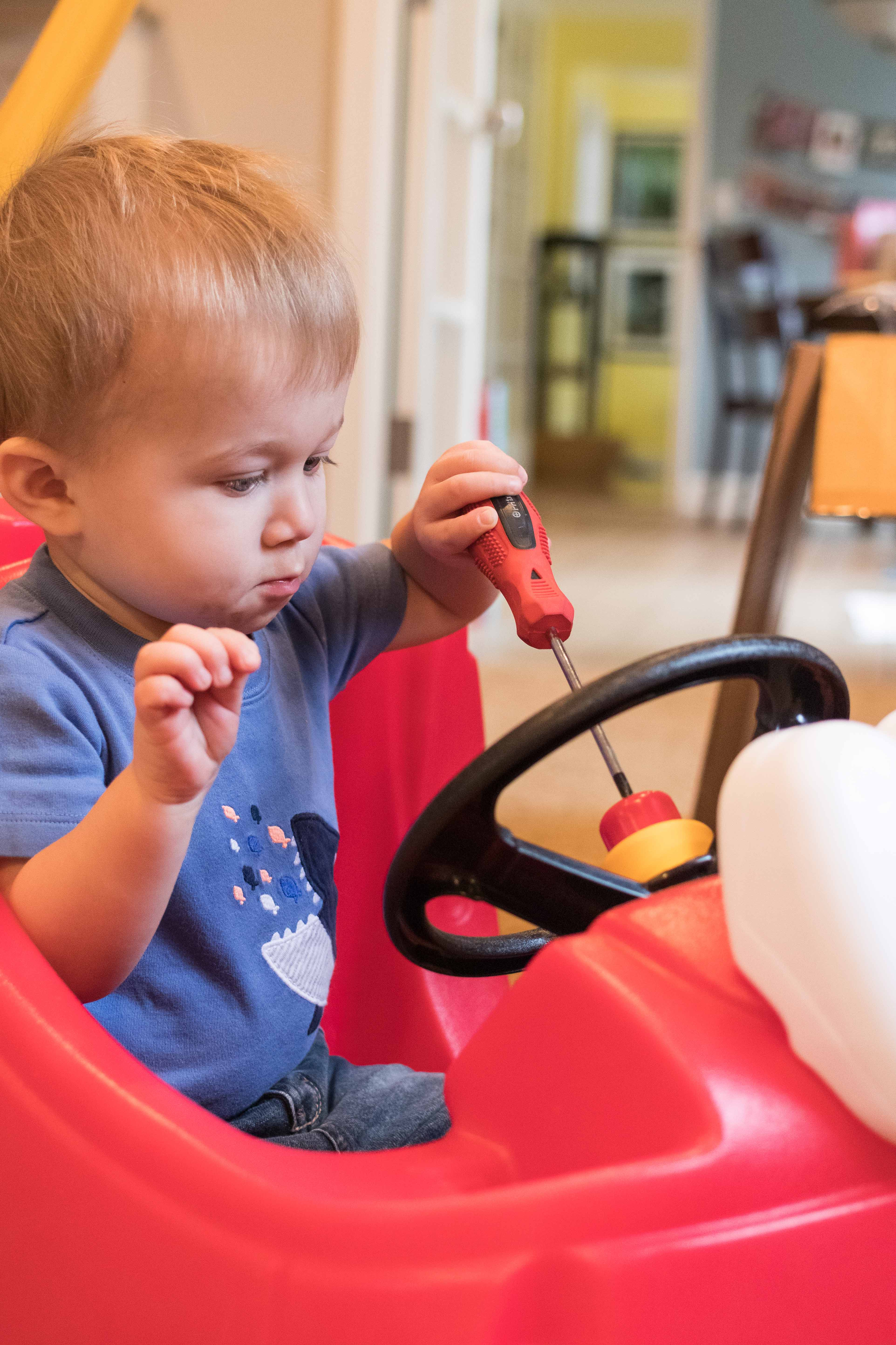 Tommy Working on the Cozy Coupe | https://www.roseclearfield.com