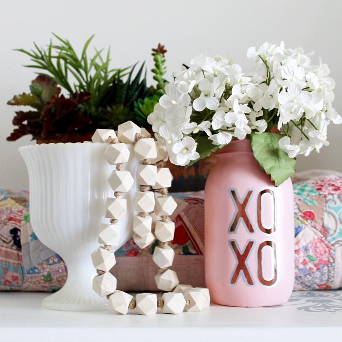 DIY Valentine's Day Mason Jar Decor - XOXO Valentine's Day Mason Jar Centerpiece via The Country Chic Cottage | https://www.roseclearfield.com