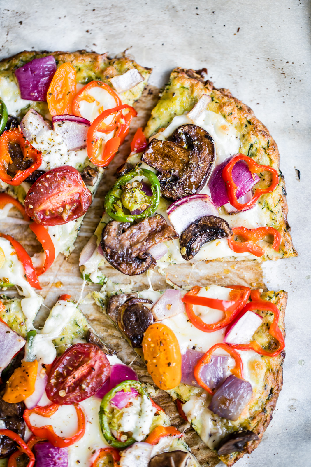 30 Healthy Dinner Recipes for Two - Zucchini Crust Veggie Pizza via Ambitious Kitchen | https://www.roseclearfield.com