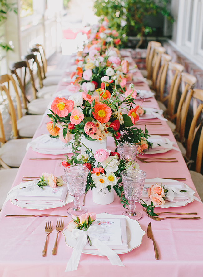 Stunning coral & pink strawberry baby shower with strawberry dotted floral centerpieces, via Inspired By This. #babyshower #flowers #floralcenterpieces | https://www.roseclearfield.com