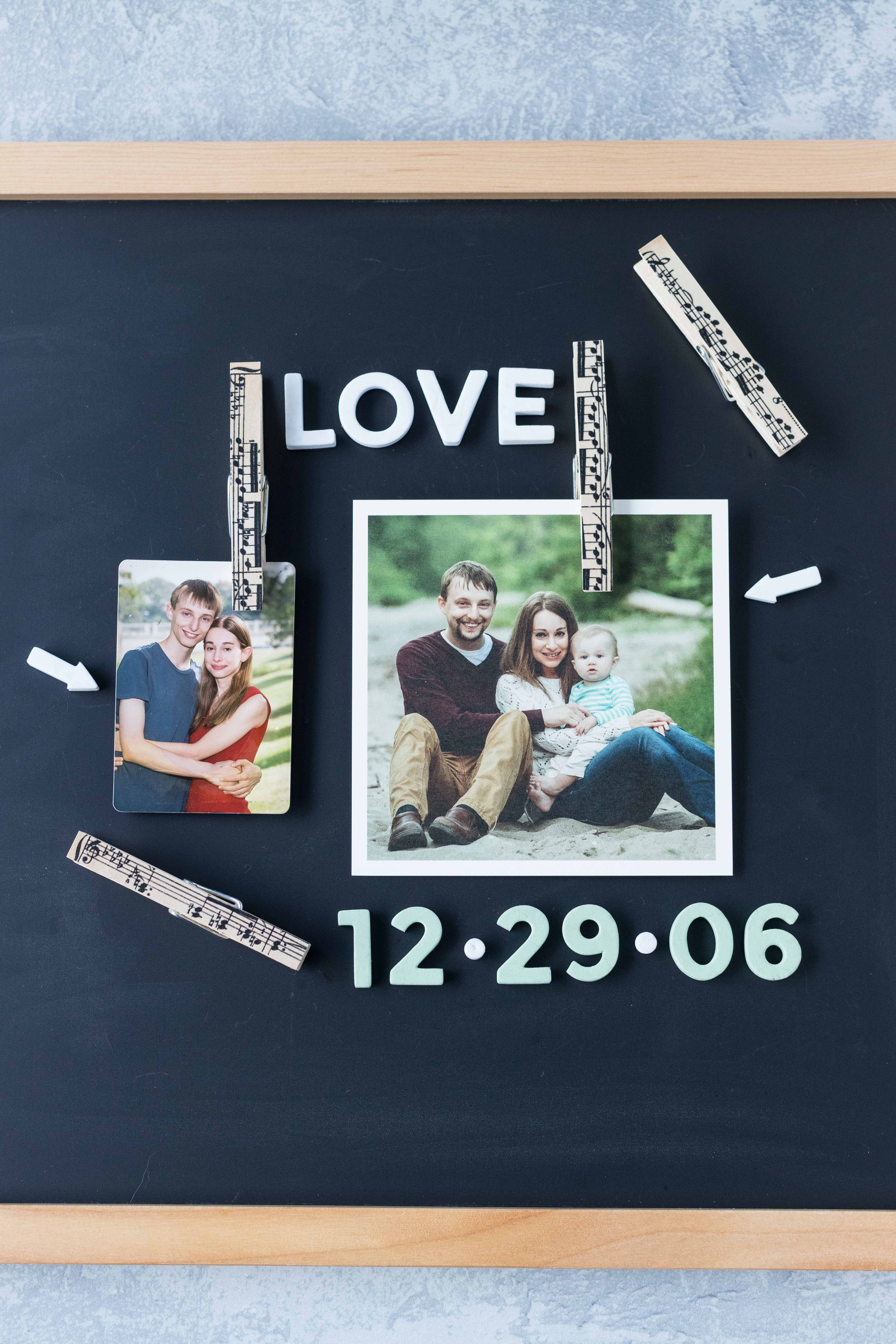Chalkboard photo display with DIY antique sheet music clothespin magnets. Such a simple, fun way to personalize a message board! #DIY #clothespins #sheetmusic | https://www.roseclearfield.com