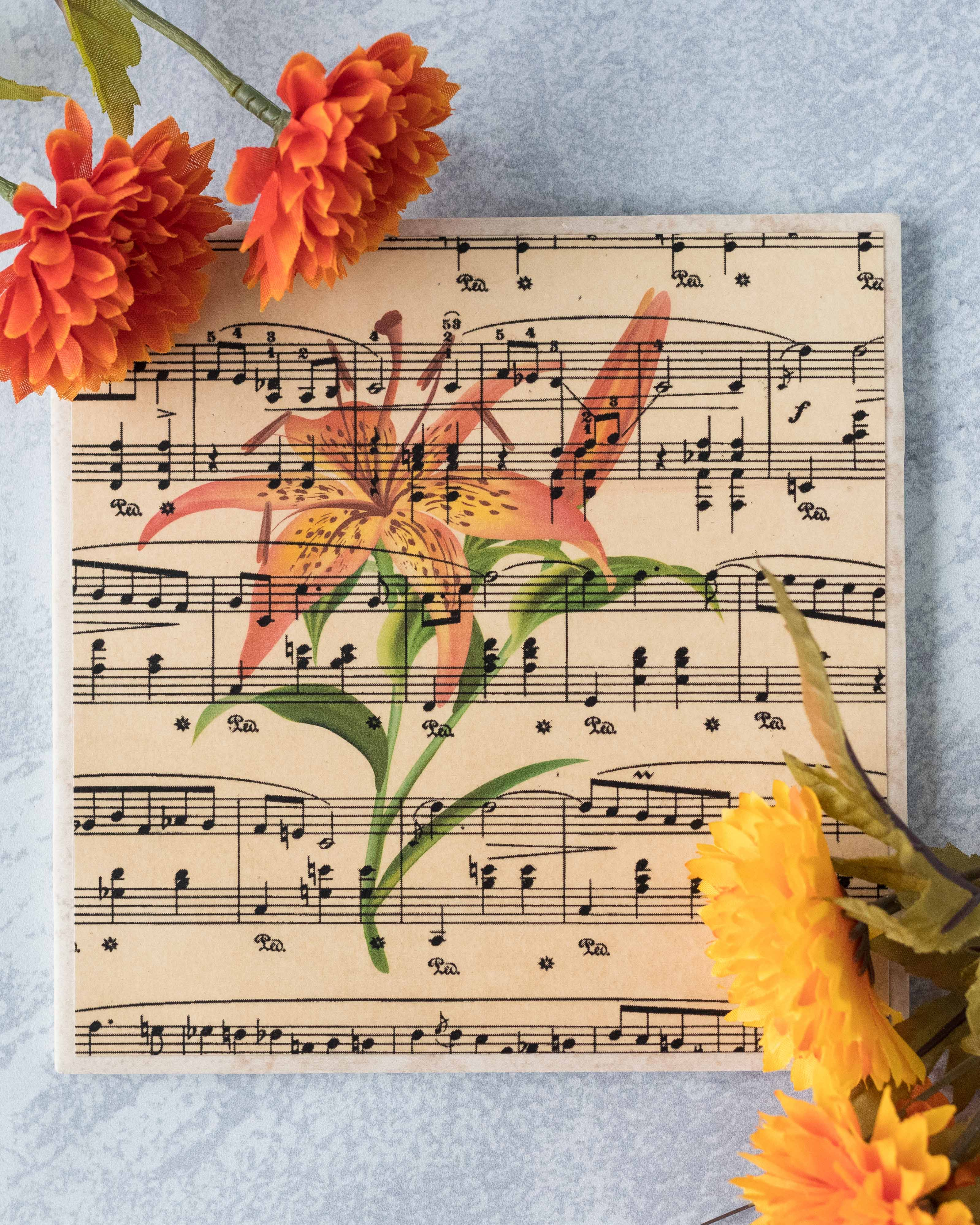 DIY antique sheet music tile with tiger lily. Such a simple, beautiful piece of handmade home decor! #DIY #sheetmusic #tigerlily | https://www.roseclearfield.com