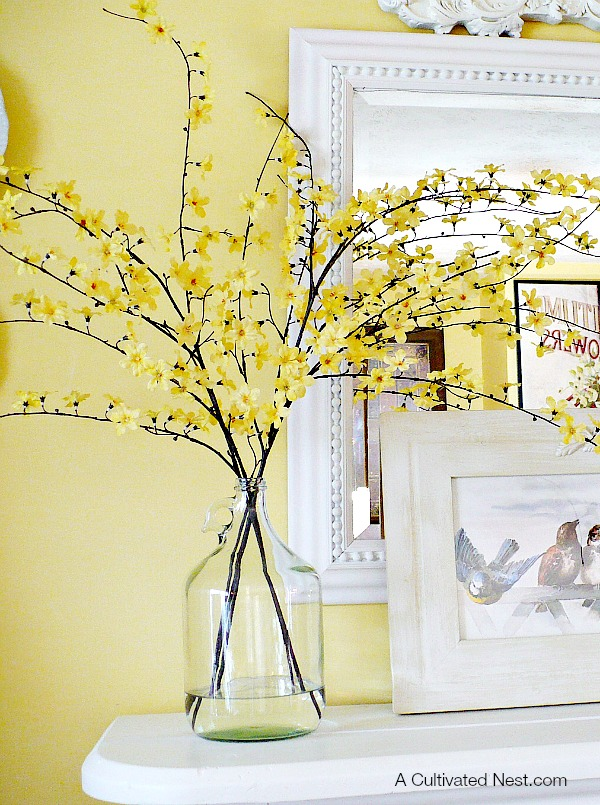 Spring Mantel Inspiration - Decorating With Glass Bottles via A Cultivated Nest | https://www.roseclearfield.com