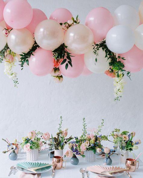 Stunning floral baby shower balloon and flowers display over elegant table settings via lieschen_de on Instagram. #babyshower #floralshower #springshowerinspiration | https://www.roseclearfield.com