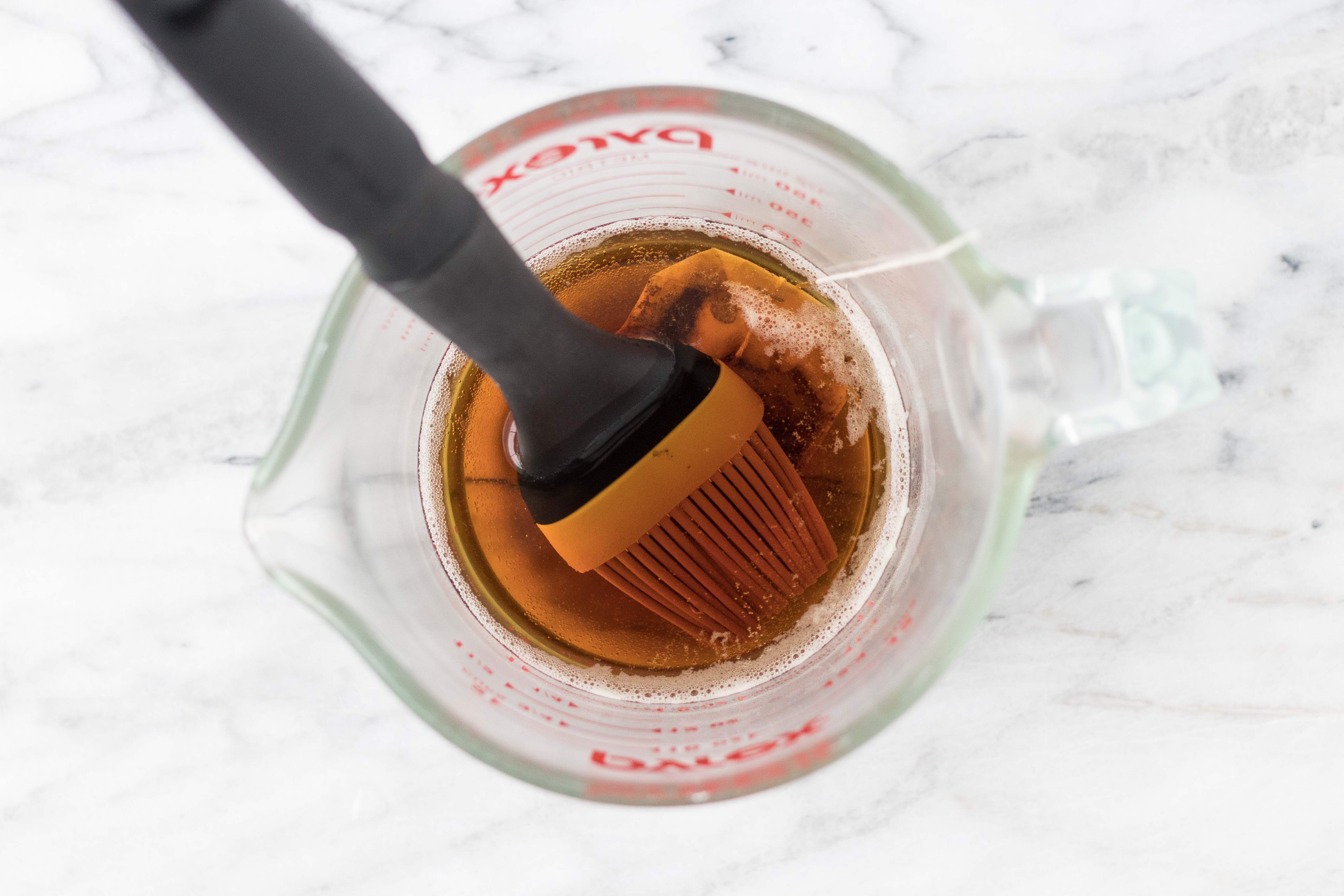 Getting ready to make new paper look antique or vintage. Brush tea on paper with a pastry or basting brush. | https://www.roseclearfield.com