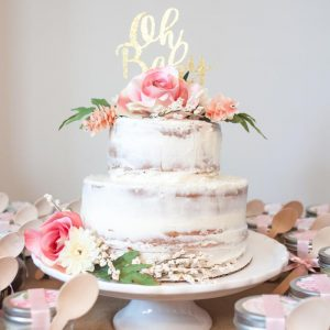 Stunning naked cake with large flowers for a floral-themed baby shower via Craft Box Girls. #showercake #floralcake #babyshower | https://www.roseclearfield.com