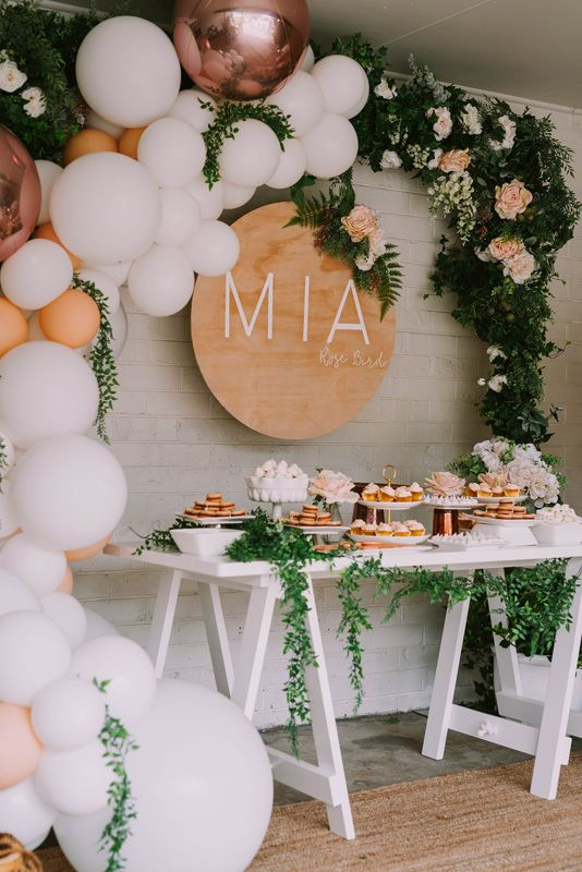 Gorgeous balloon and floral arch over a food display, perfect for a baby shower. #floral #babyshower #balloonarch | https://www.roseclearfield.com