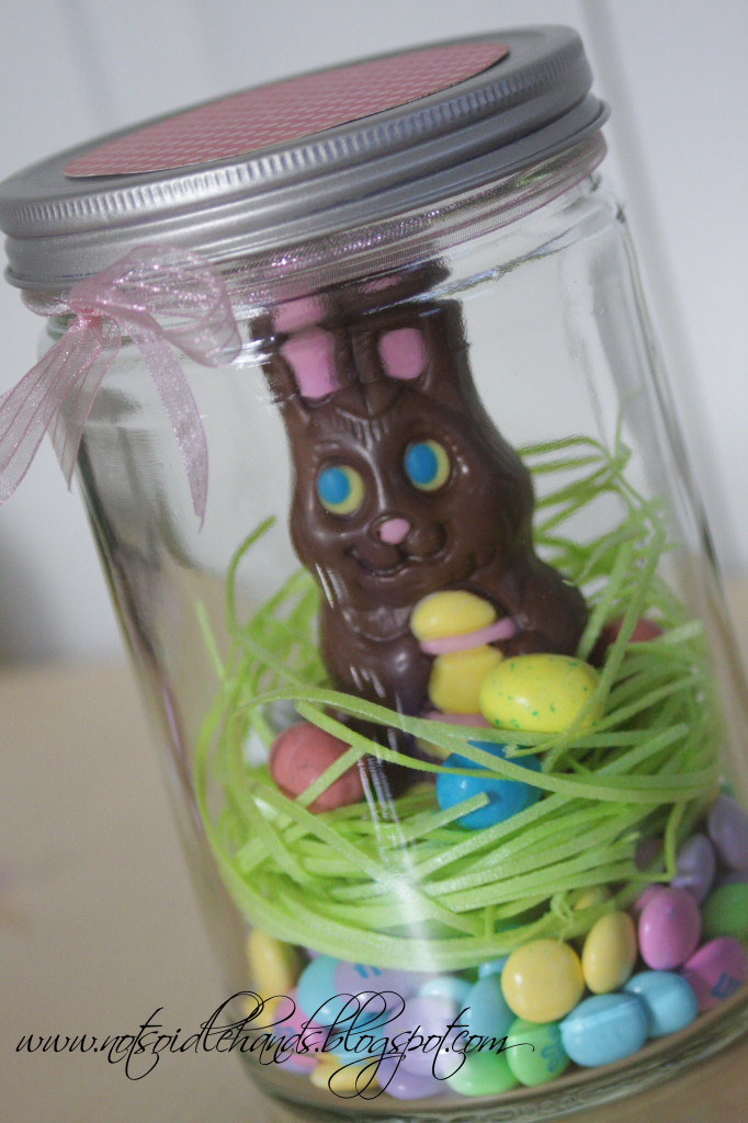 Easter grass and candies nest for a chocolate bunny. Too cute! via Not So Idle Hands #Easter #chocolatebunny #masonjars | https://www.roseclearfield.com