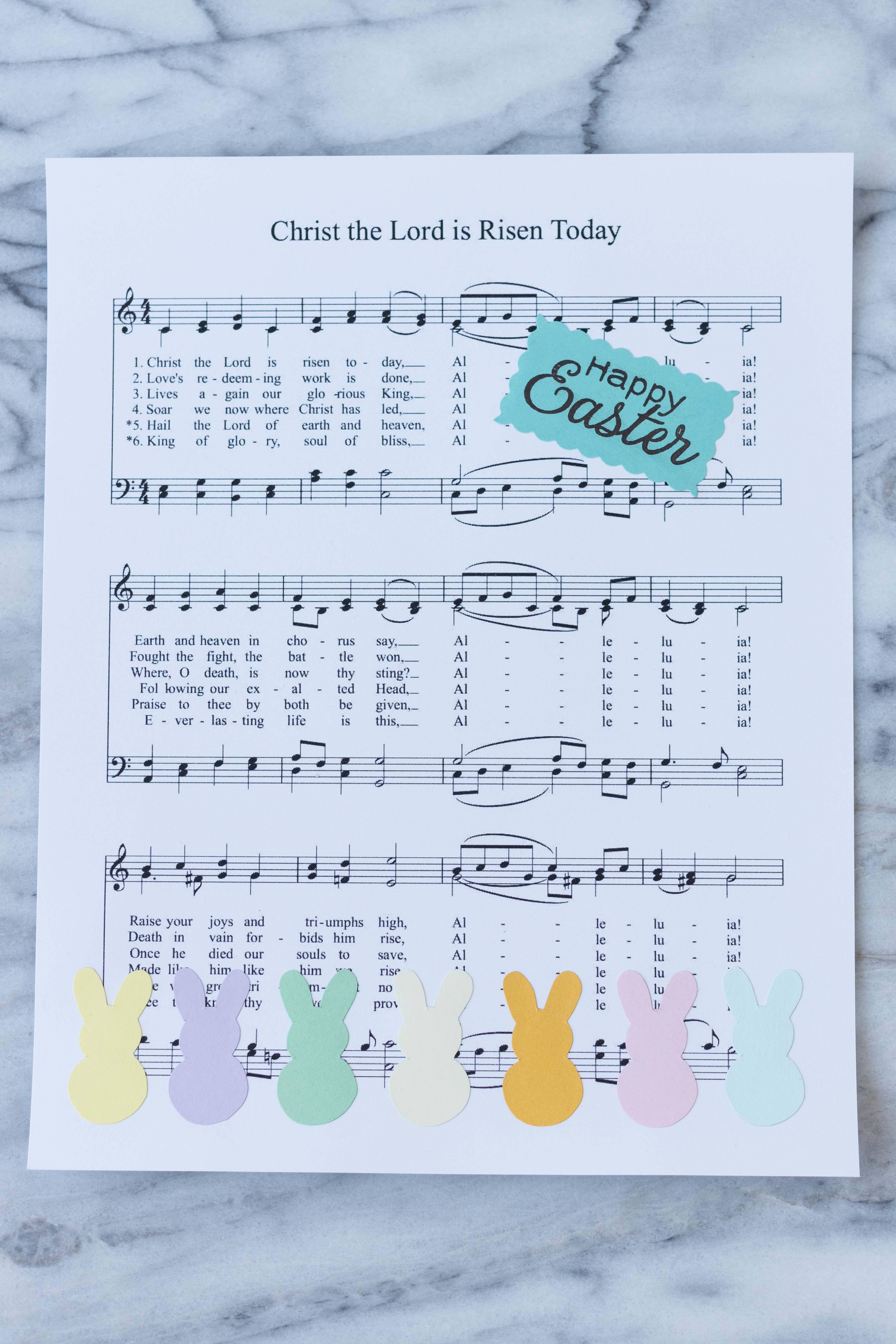 DIY Easter sheet music wall decor in progress! #Easter #DIY #sheetmusic | https://www.roseclearfield.com
