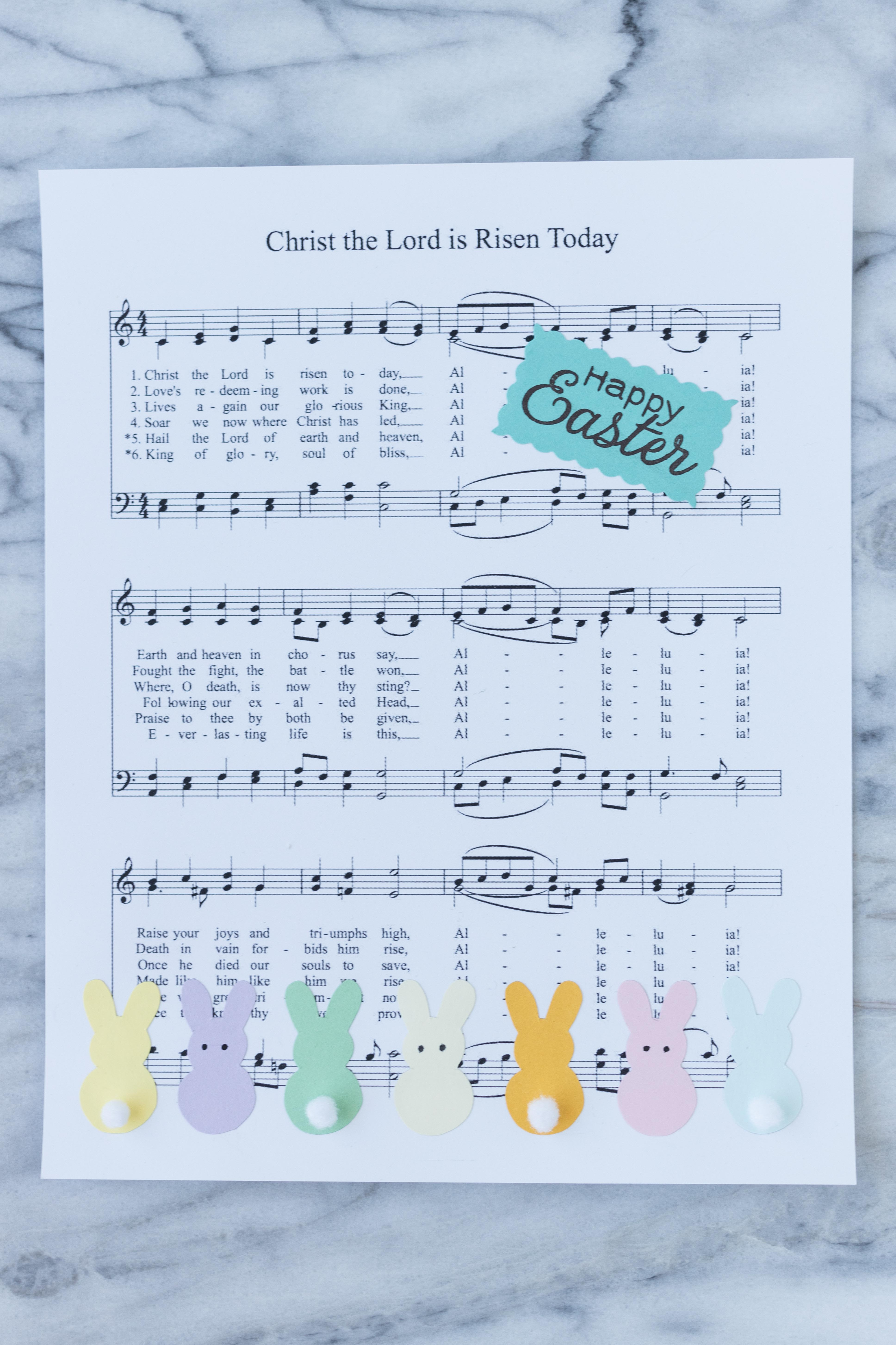 DIY Easter sheet music wall decor in progress! Pom pom tails and eyes add a fun touch to the bunnies. #Easter #DIY #sheetmusic | https://www.roseclearfield.com