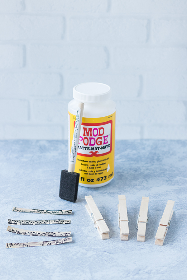 Supplies for DIY sheet music clothespin magnets. #DIY #sheetmusic #ModPodgecraft   https://www.roseclearfield.com